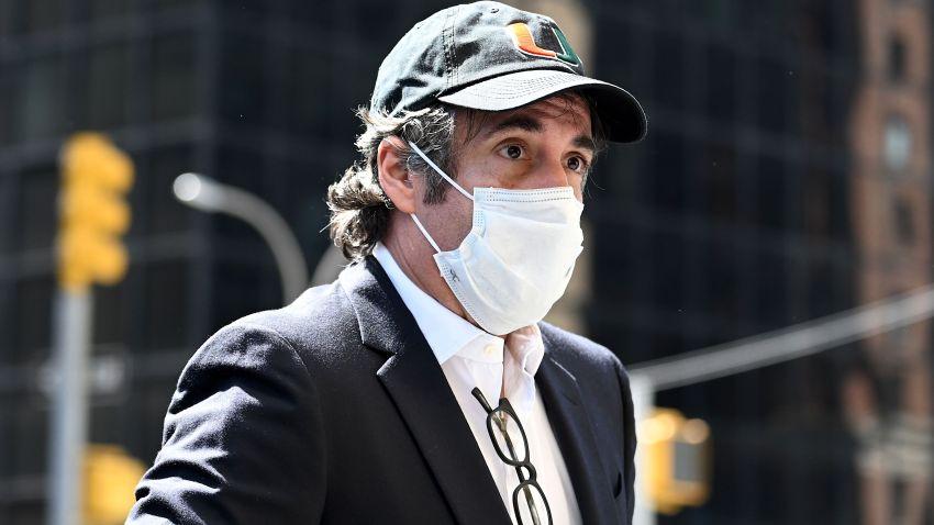 Michael Cohen returns home wearing mask.