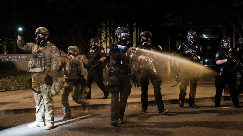 Federal officers use tear gas and other crowd dispersal munitions on protesters outside the Multnomah County Justice Center on July 17, 2020 in Portland, Oregon. Federal law enforcement agencies attempt to intervene as protests continue in Portland.