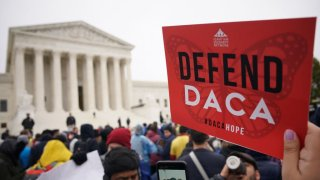 """Immigration rights activists take part in a rally in front of the US Supreme Court in Washington, DC on November 12, 2019. - The US Supreme Court hears arguments on November 12, 2019 on the fate of the """"Dreamers,"""" an estimated 700,000 people brought to the country illegally as children but allowed to stay and work under a program created by former president Barack Obama.Known as Deferred Action for Childhood Arrivals or DACA, the program came under attack from President Donald Trump who wants it terminated, and expired last year after the Congress failed to come up with a replacement."""